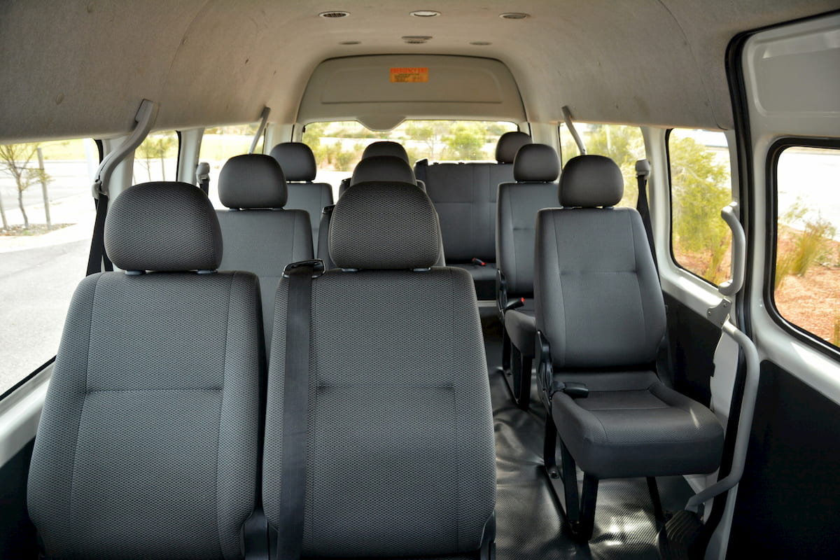 The inside of a 12 seat Toyota Commuter bus