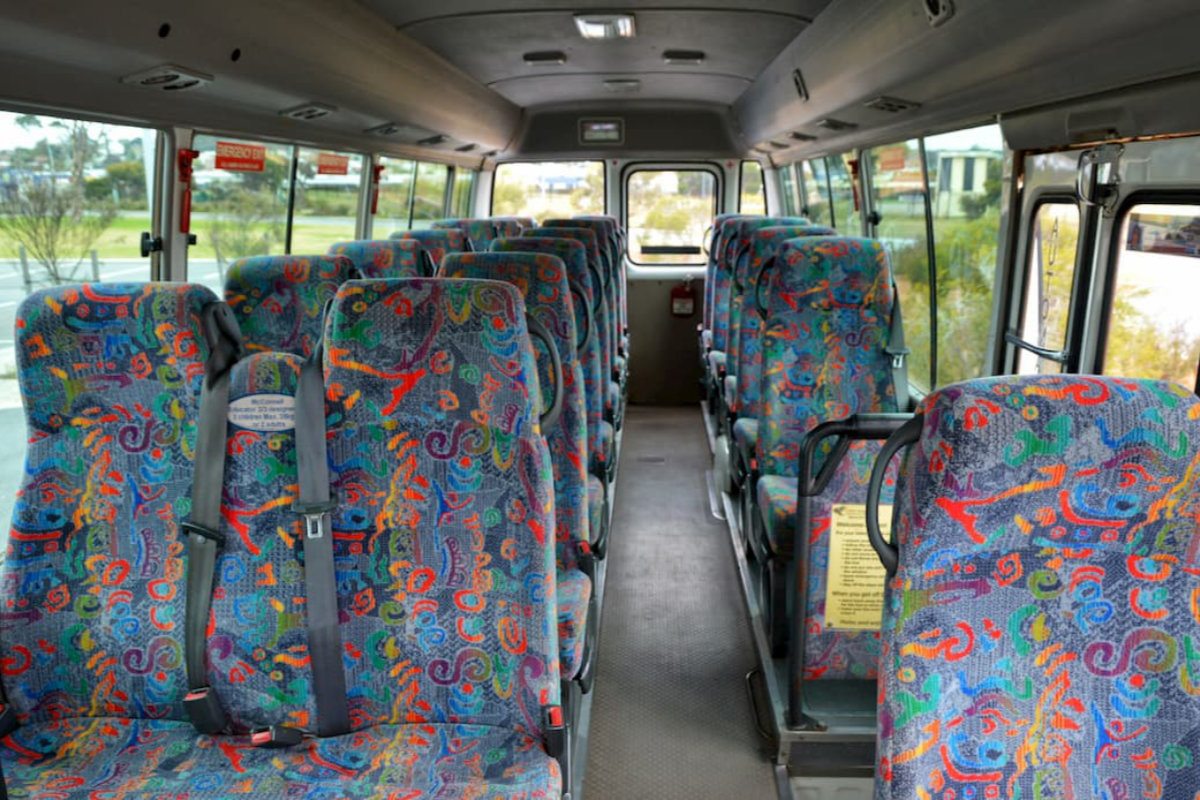 The inside of a 22 seat Toyota Coaster bus