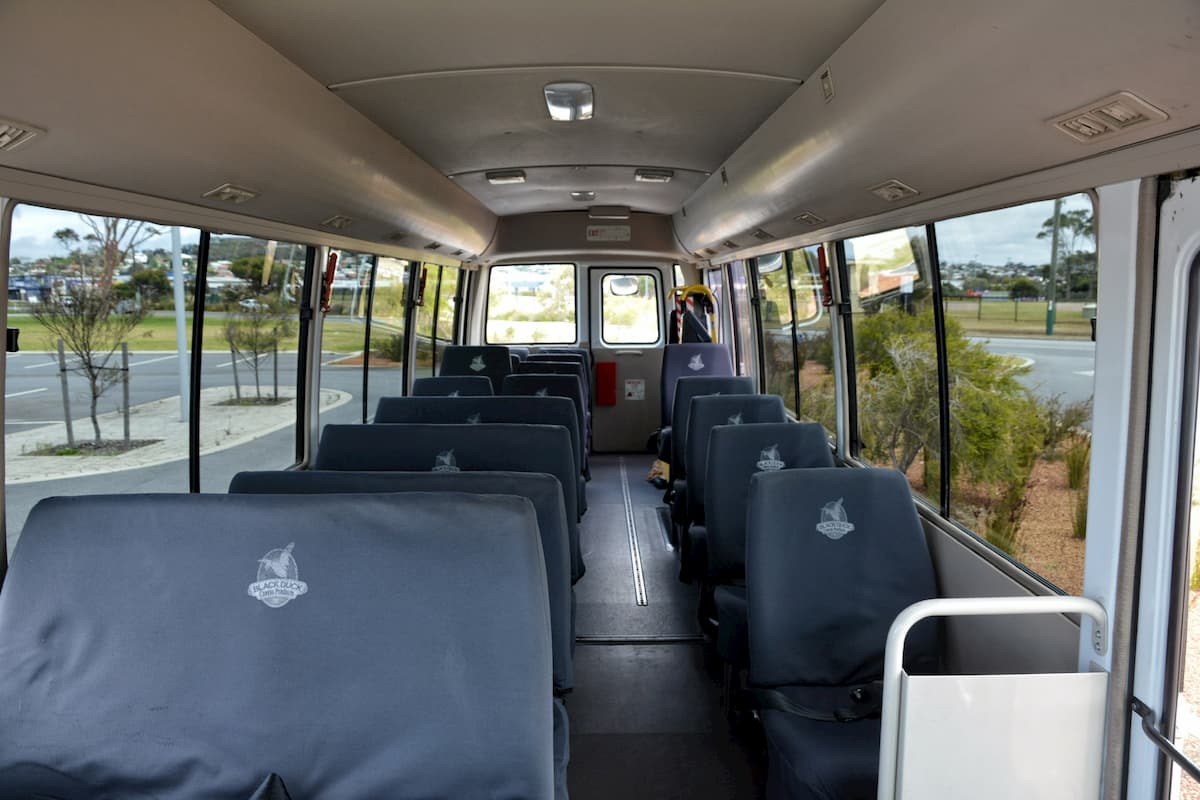 The inside of a 21 seat Mitsubishi Rosa bus