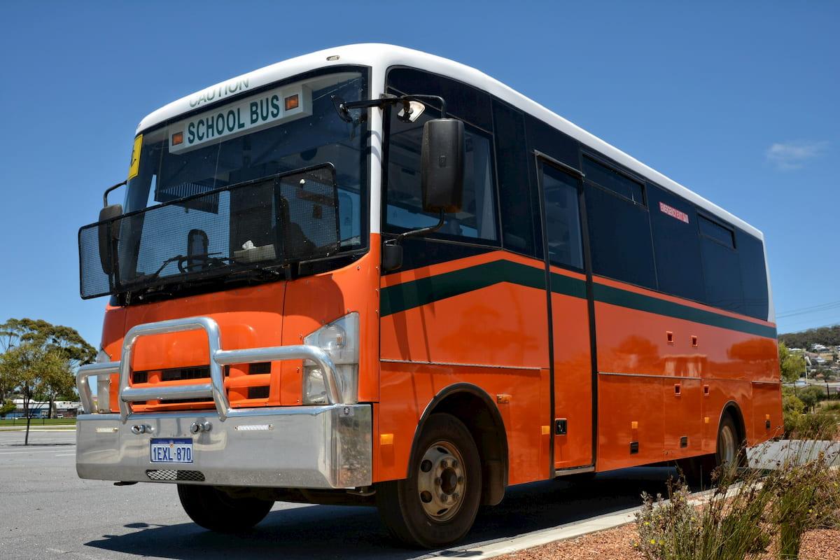 School bus orange Isuzu 34 seat coach