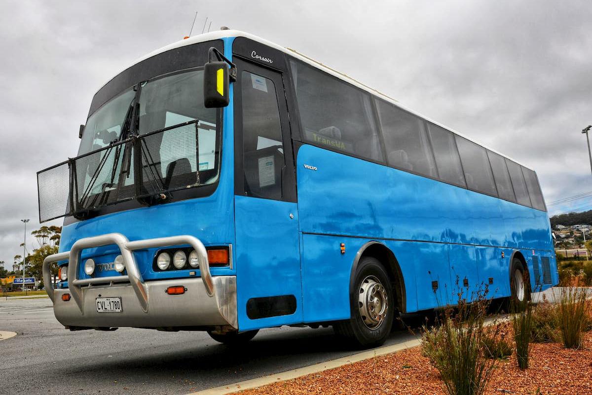 Large blue 38 seat Volvo coach