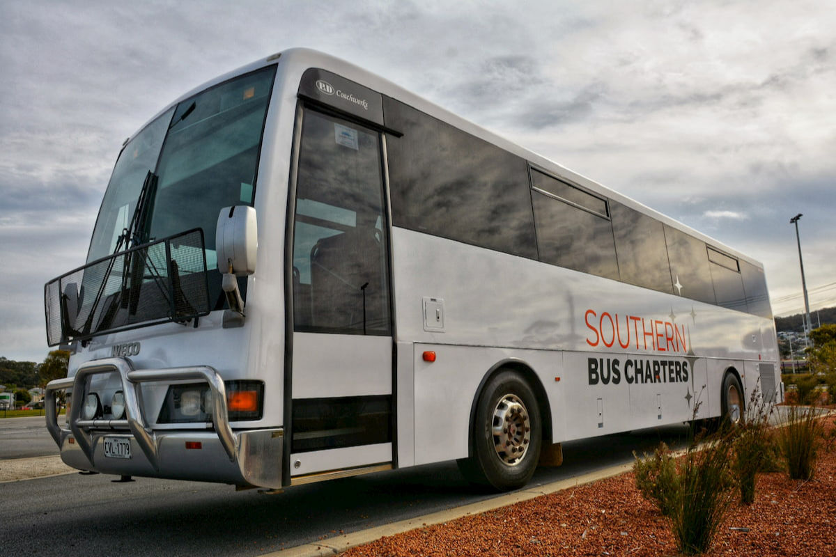 Large white 57 seat Iveco coach