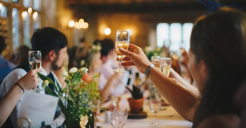 Champagne glasses raised at a function